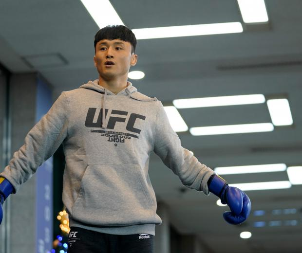 Dooho Choi of South Korea holds an open training session for fans and media during the UFC Fight Night Open Workouts at City Hall on December 18, 2019 in Busan, South Korea. (Photo by Jeff Bottari/Zuffa LLC)
