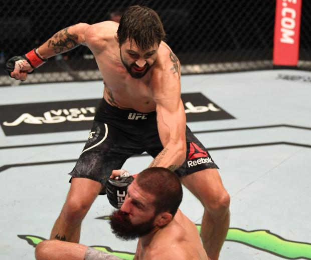 Carlos Condit punches Court McGee in their welterweight bout during the UFC Fight Night event inside Flash Forum on UFC Fight Island on October 04, 2020 in Abu Dhabi, United Arab Emirates. (Photo by Josh Hedges/Zuffa LLC)