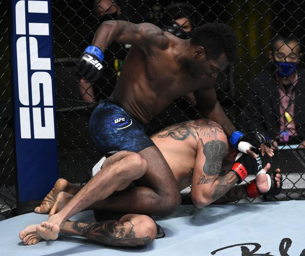 Dwight Grant punches Daniel Rodriguez in their welterweight fight during the UFC Fight Night event at UFC APEX on August 22, 2020 in Las Vegas, Nevada. (Photo by Chris Unger/Zuffa LLC)