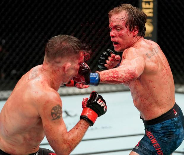 JACKSONVILLE, FLORIDA - MAY 16: (R-L) Nate Landwehr punches Darren Elkins in their featherweight fight during the UFC Fight Night event at VyStar Veterans Memorial Arena on May 16, 2020 in Jacksonville, Florida. (Photo by Cooper Neill/Zuffa LLC)