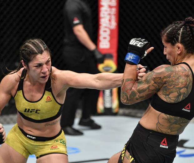 Bethe Correia of Brazil punches Pannie Kianzad of Iran in their bantamweight fight during the UFC Fight Night event inside Flash Forum on UFC Fight Island on July 26, 2020 in Yas Island, Abu Dhabi, United Arab Emirates. (Photo by Jeff Bottari/Zuffa LLC)