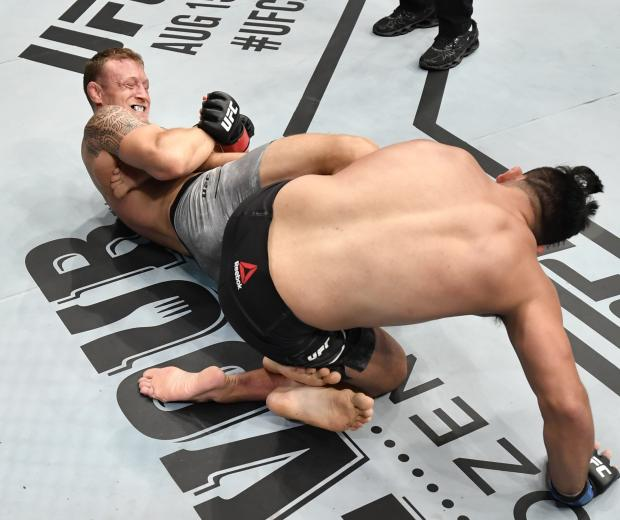 Jack Hermansson of Sweden secures a heel hook submission against Kelvin Gastelum in their middleweight bout during the UFC Fight Night event inside Flash Forum on UFC Fight Island on July 19, 2020 in Yas Island, Abu Dhabi, United Arab Emirates. (Photo by Jeff Bottari/Zuffa LLC)