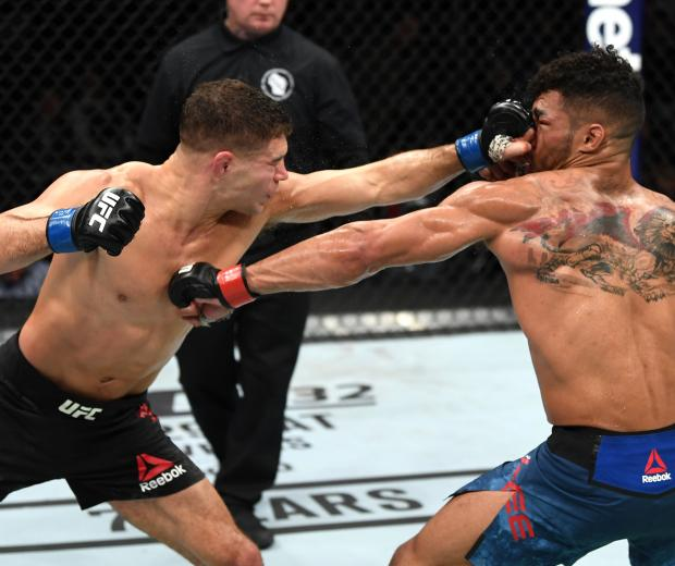 Al Iaquinta punches Kevin Lee in their lightweight bout during the UFC Fight Night event at Fiserv Forum on December 15, 2018 in Milwaukee, Wisconsin. (Photo by Jeff Bottari/Zuffa LLC)