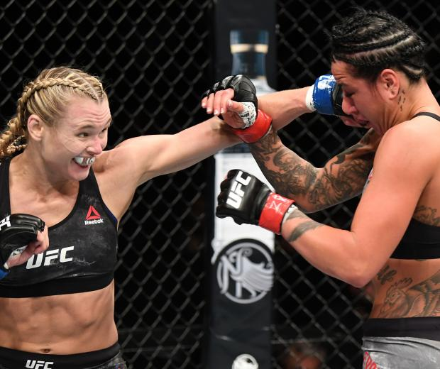 Andrea Lee punches Ashlee Evans-Smith in their women's flyweight bout during the UFC Fight Night event at Talking Stick Resort Arena on February 17, 2019 in Phoenix, Arizona. (Photo by Josh Hedges/Zuffa LLC)