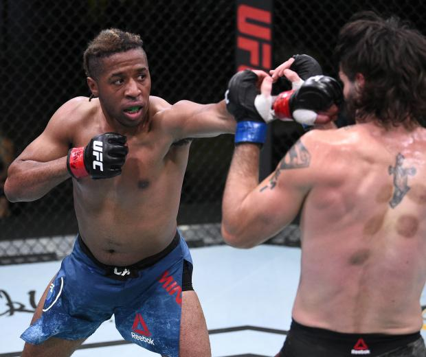 Carlton Minus punches Matthew Semelsberger in their welterweight fight during the UFC Fight Night event at UFC APEX on August 22, 2020 in Las Vegas, Nevada. (Photo by Chris Unger/Zuffa LLC)