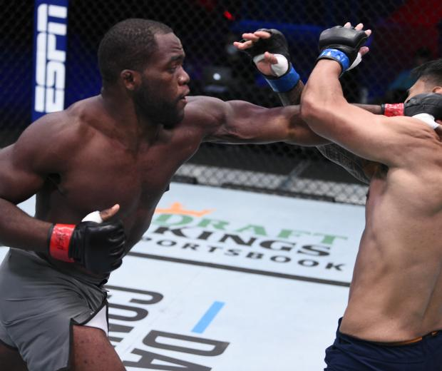Tafon Nchukwi punches Al Matavao in a light heavyweight bout during week six of Dana White's Contender Series season four at UFC APEX on September 08, 2020 in Las Vegas, Nevada. (Photo by Chris Unger/DWCS LLC/Zuffa LLC)