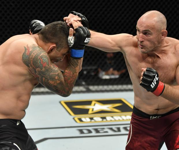Aleksei Oleinik of Russia punches Fabricio Werdum in their heavyweight fight during the UFC 249 event at VyStar Veterans Memorial Arena on May 09, 2020 in Jacksonville, Florida. (Photo by Jeff Bottari/Zuffa LLC)