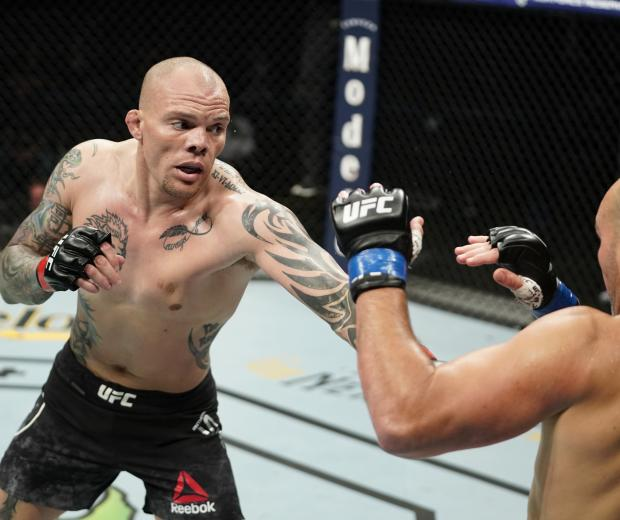 Anthony Smith punches Glover Teixeira of Brazil in their light heavyweight bout during the UFC Fight Night Event at VyStar Veterans Memorial Arena on May 13, 2020 in Jacksonville, Florida. (Photo by Cooper Neill/Zuffa LLC)