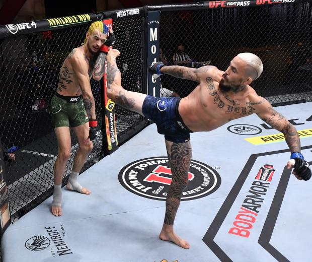 Marlon Vera of Ecuador kicks Sean O'Malley in their bantamweight bout during the UFC 252 event at UFC APEX on August 15, 2020 in Las Vegas, Nevada. (Photo by Jeff Bottari/Zuffa LLC)
