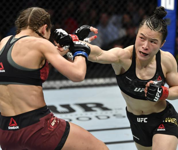 Zhang Weili of China punches Joanna Jedrzejczyk of Poland in their UFC strawweight championship fight during the UFC 248 event at T-Mobile Arena on March 07, 2020 in Las Vegas, Nevada. (Photo by Jeff Bottari/Zuffa LLC)