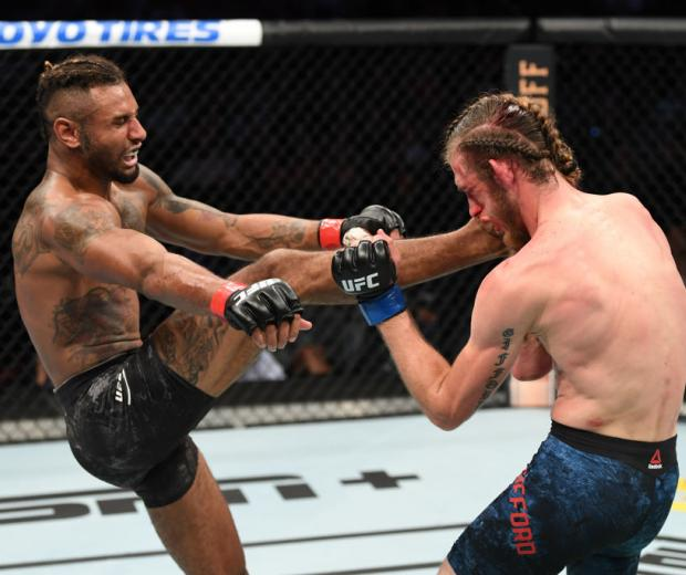 TAMPA, FLORIDA - OCTOBER 12: (L-R) Mike Davis kicks Thomas Gifford in their lightweight bout during the UFC Fight Night event at Amalie Arena on October 12, 2019 in Tampa, Florida. (Photo by Josh Hedges/Zuffa LLC)