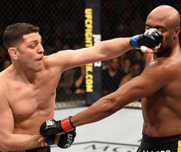 LAS VEGAS, NV - JANUARY 31: (L-R) Nick Diaz punches Anderson Silva in their middleweight bout during the UFC 183 event at the MGM Grand Garden Arena on January 31, 2015 in Las Vegas, Nevada. (Photo by Josh Hedges/Zuffa LLC)