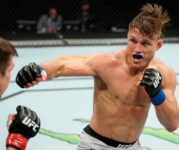 JACKSONVILLE, FLORIDA - MAY 13: Drew Dober punches Alexander Hernandez in their bantamweight bout during the UFC Fight Night Event at VyStar Veterans Memorial Arena on May 13, 2020 in Jacksonville, Florida. (Photo by Cooper Neill/Zuffa LLC)