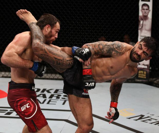 BRASILIA, BRAZIL - MARCH 14: (R-L) Elizeu dos Santos of Brazil kicks Aleksei Kunchenko of Russia in their welterweight fight during the UFC Fight Night event on March 14, 2020 in Brasilia, Brazil. (Photo by Buda Mendes/Zuffa LLC)