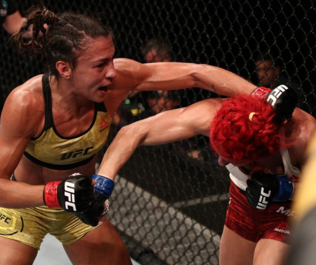 MARCH 14: (L-R) Amanda Ribas of Brazil punches Randa Markos of Canada in their strawweight fight during the UFC Fight Night event on March 14, 2020 in Brasilia, Brazil. (Photo by Buda Mendes/Zuffa LLC)