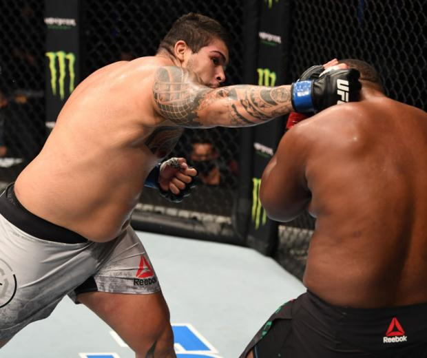 Carlos Felipe of Brazil punches Yorgan De Castro of Cape Verde in their heavyweight bout during the UFC Fight Night event inside Flash Forum on UFC Fight Island on October 04, 2020 in Abu Dhabi, United Arab Emirates.(Photo by Josh Hedges)