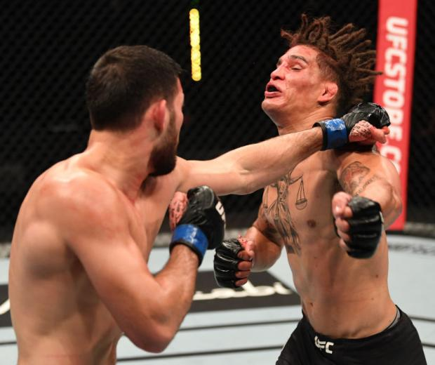 Nassourdine Imavov of Russia punches Jordan Williams in their middleweight bout during the UFC Fight Night event inside Flash Forum on UFC Fight Island on October 04, 2020 in Abu Dhabi, United Arab Emirates. (Photo by Josh Hedges/Zuffa LLC)