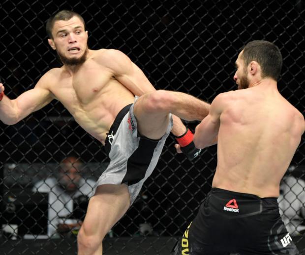 Umar Nurmagomedov of Russia kicks Sergey Morozov of Kazakhstan in a bantamweight fight during the UFC Fight Night event at Etihad Arena on UFC Fight Island on January 20, 2021 in Abu Dhabi, United Arab Emirates. (Photo by Jeff Bottari/Zuffa LLC)
