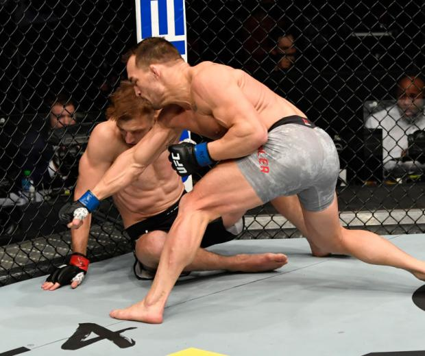 Michael Chandler punches Dan Hooker of New Zealand in a lightweight fight during the UFC 257 event inside Etihad Arena on UFC Fight Island on January 23, 2021 in Abu Dhabi, United Arab Emirates. (Photo by Jeff Bottari/Zuffa LLC)