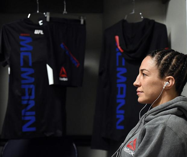Sara McMann rests backstage in the locker room during the UFC Fight Night event at Bridgestone Arena on August 8, 2015 in Nashville, Tennessee. (Photo by Mike Roach/Zuffa LLC)