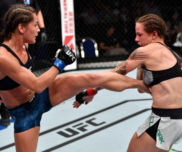 Jessica Eye kicks Jessica-Rose Clark of Australia in their women's flyweight bout during the UFC Fight Night event at the Singapore Indoor Stadium on June 23, 2018 in Singapore. (Photo by Jeff Bottari/Zuffa LLC)