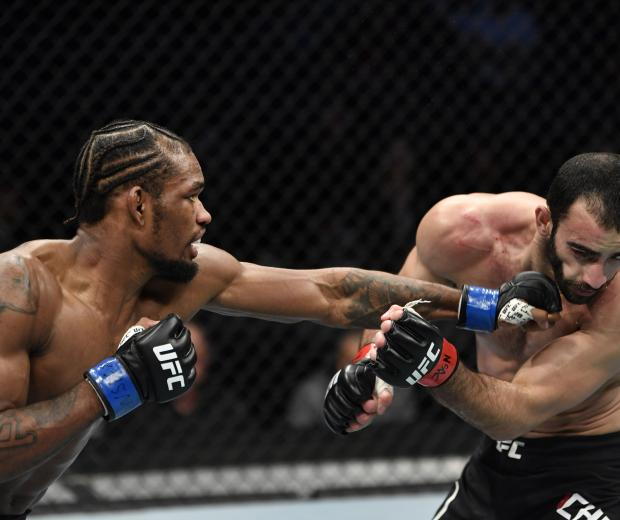 Jamall Emmers punches Guido Cannetti of Argentina in their featherweight fight during the UFC 248 event at T-Mobile Arena on March 07, 2020 in Las Vegas, Nevada. (Photo by Jeff Bottari/Zuffa LLC)