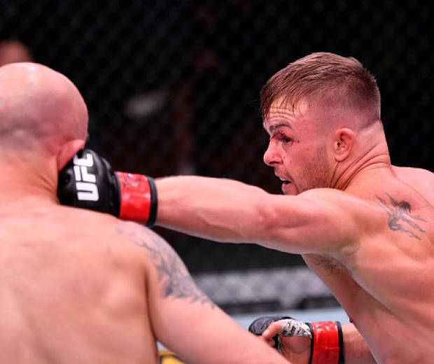 Cody Stamman punches Brian Kelleher in their featherweight bout during the UFC 250 event at UFC APEX on June 06, 2020 in Las Vegas, Nevada. (Photo by Jeff Bottari/Zuffa LLC)
