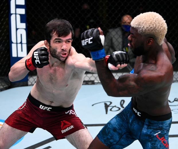 Timur Valiev of Russia punches Trevin Jones in their fight during the UFC Fight Night event at UFC APEX on August 22, 2020 in Las Vegas, Nevada. (Photo by Chris Unger/Zuffa LLC)