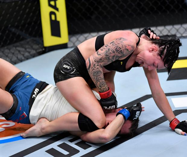 Mallory Martin punches Hannah Cifers in their strawweight fight during the UFC Fight Night event at UFC APEX on August 29, 2020 in Las Vegas, Nevada. (Photo by Jeff Bottari/Zuffa LLC)