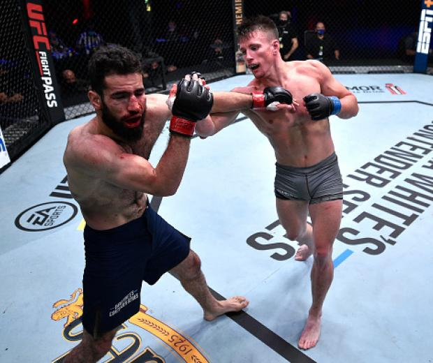 Collin Anglin punches Muhammad Naimov in their featherweight bout during week seven of Dana White's Contender Series season four at UFC APEX on September 15, 2020 in Las Vegas, Nevada. (Photo by Chris Unger/DWCS LLC/Zuffa LLC)