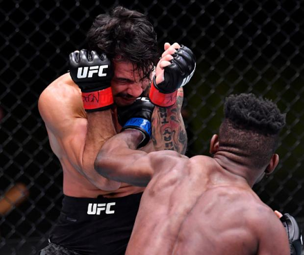 Manel Kape of Angola punches Alexandre Pantoja of Brazil in their flyweight fight during the UFC Fight Night event at UFC APEX on February 06, 2021 in Las Vegas, Nevada. (Photo by Chris Unger/Zuffa LLC)