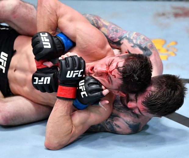 Derrick Minner works for a submission against Charles Rosa in a featherweight bout during the UFC Fight Night event at UFC APEX on February 20, 2021 in Las Vegas, Nevada. (Photo by Chris Unger/Zuffa LLC)