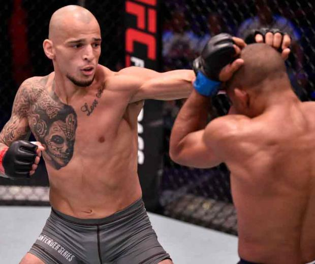 Ray Rodriguez punches Tony Gravely in their bantamweight bout during Dana White's Contender Series week 8 at the UFC Apex on August 13, 2019 in Las Vegas, Nevada. (Photo by Chris Unger/DWCS LLC/Zuffa LLC)