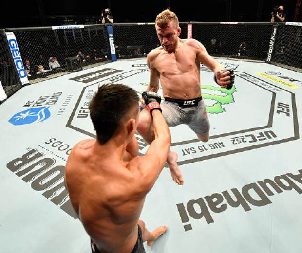 Davey Grant of England launches a flying knee against Martin Day in their bantamweight fight during the UFC 251 event at Flash Forum on UFC Fight Island on July 12, 2020 on Yas Island, Abu Dhabi, United Arab Emirates. (Photo by Jeff Bottari/Zuffa LLC)
