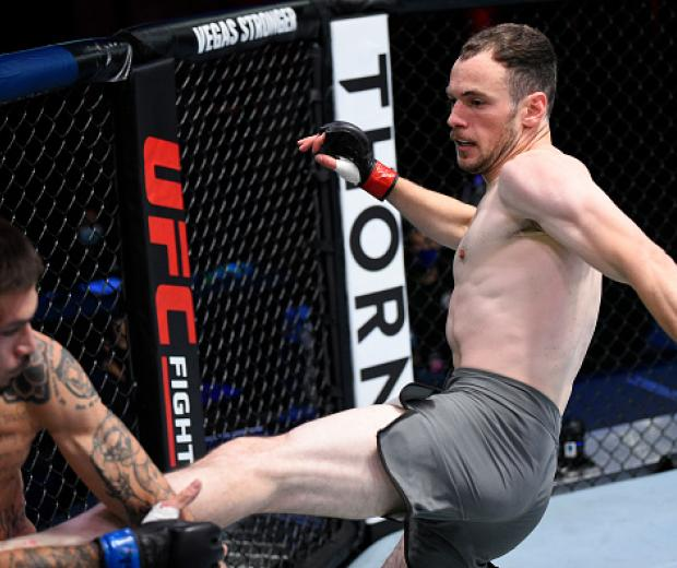 Uros Medic of Serbia kicks Mikey Gonzalez in their lightweight bout during Dana White's Contender Series season 4 week one at UFC APEX on August 04, 2020 in Las Vegas, Nevada. (Photo by Chris Unger/DWCS LLC/Zuffa LLC)