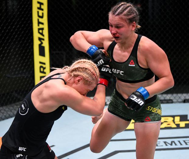 Julija Stoliarenko of Lithuania punches Yana Kunitskaya of Russia in their bantamweight fight during the UFC Fight Night event at UFC APEX on August 08, 2020 in Las Vegas, Nevada. (Photo by Chris Unger/Zuffa LLC)