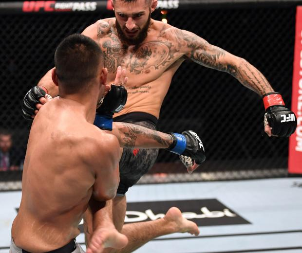 Charles Jourdain of Canada kicks Josh Culibao of Australia in their featherweight bout during the UFC Fight Night event inside Flash Forum on UFC Fight Island on October 04, 2020 in Abu Dhabi, United Arab Emirates. (Photo by Josh Hedges/Zuffa LLC)