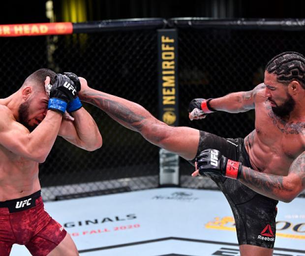 Max Griffin kicks Ramiz Brahimaj in a welterweight fight during the UFC Fight Night event at UFC APEX on November 07, 2020 in Las Vegas, Nevada. (Photo by Jeff Bottari/Zuffa LLC)