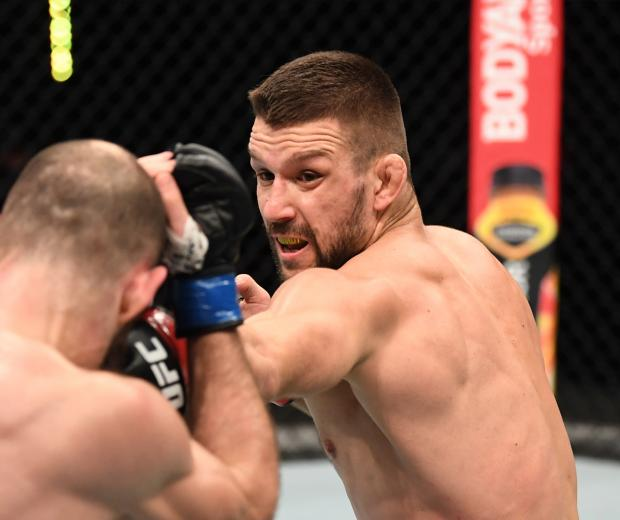 Mateusz Gamrot of Poland punches Guram Kutateladze of Georgia in their lightweight bout during the UFC Fight Night event inside Flash Forum on UFC Fight Island on October 18, 2020 in Abu Dhabi, United Arab Emirates. (Photo by Josh Hedges/Zuffa LLC)