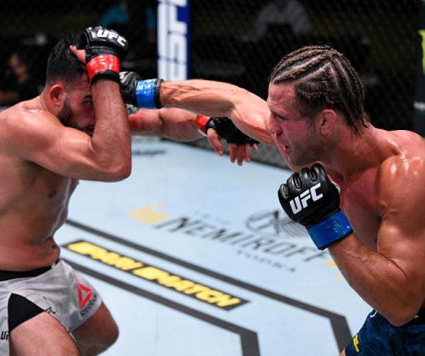 Alexander Munoz punches Nasrat Haqparast of Germany in their lightweight fight during the UFC Fight Night event at UFC APEX on August 08, 2020 in Las Vegas, Nevada. (Photo by Chris Unger/Zuffa LLC)