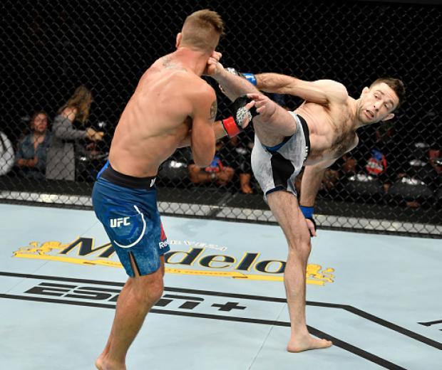 Ryan Hall kicks Darren Elkins in their featherweight bout during the UFC Fight Night event at Golden 1 Center on July 13, 2019 in Sacramento, California. (Photo by Jeff Bottari/Zuffa LLC)