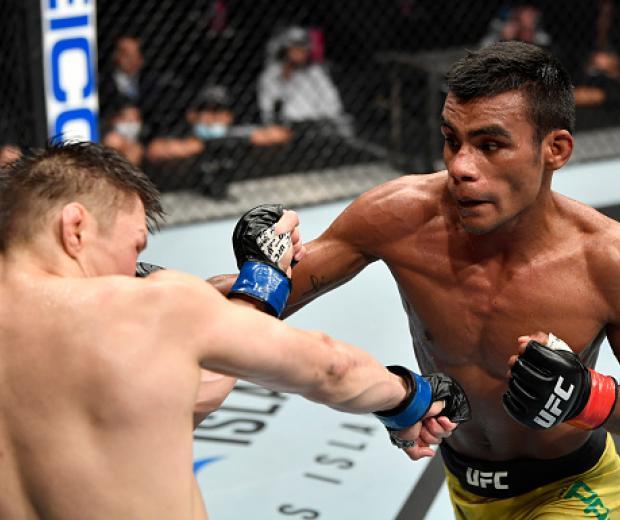 Raulian Paiva of Brazil punches Zhalgas Zhumagulov of Kazakhstan in their flyweight fight during the UFC 251 event at Flash Forum on UFC Fight Island on July 12, 2020 on Yas Island, Abu Dhabi, United Arab Emirates. (Photo by Jeff Bottari/Zuffa LLC)