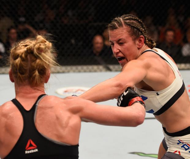 Miesha Tate punches Holly Holm in their UFC women's bantamweight championship bout during the UFC 196 event inside MGM Grand Garden Arena on March 5, 2016 in Las Vegas, Nevada. (Photo by Josh Hedges/Zuffa LLC)