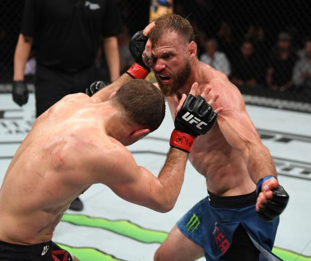 Donald Cerrone punches Al Iaquinta in their lightweight bout during the UFC Fight Night