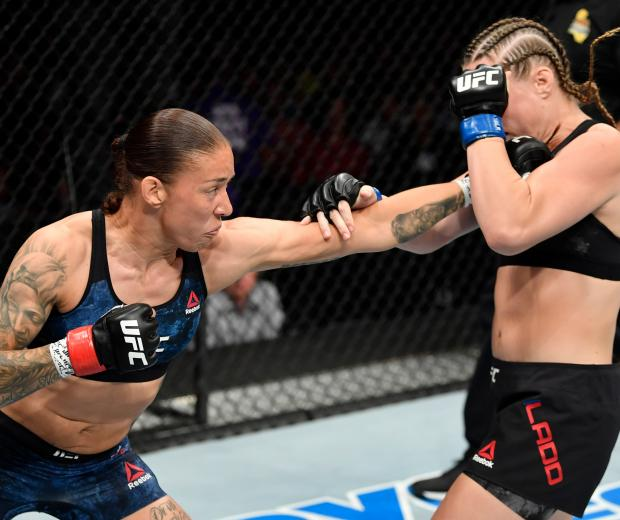Germaine de Randamie of the Netherlands punches Aspen Ladd in their women's bantamweight bout during the UFC Fight Night