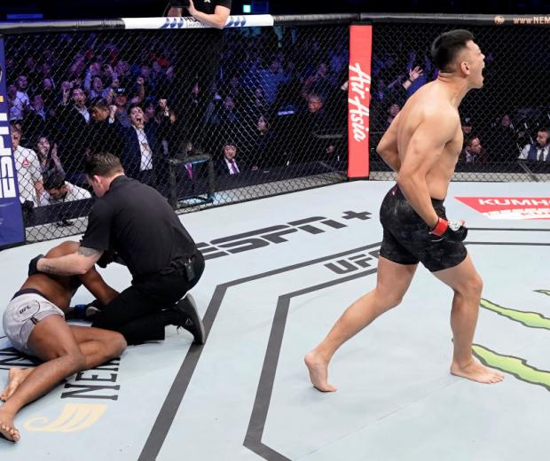 Da-un Jung of South Korea celebrates after knocking out Mike Rodriguez in their light heavyweight fight during the UFC Fight Night