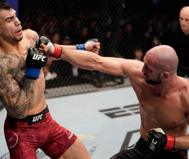 Volkan Oezdemir of Switzerland punches Aleksandar Rakic of Austria in their light heavyweight fight during the UFC Fight Night