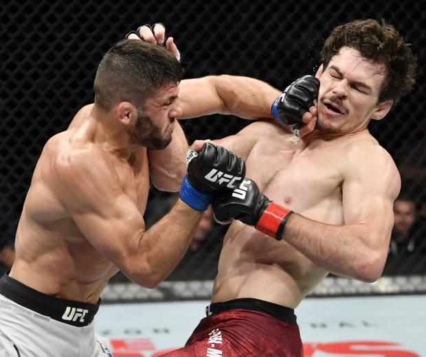 Arman Tsarukyan of Georgia punches Olivier Aubin-Mercier of Canada in their lightweight bout during the UFC 240