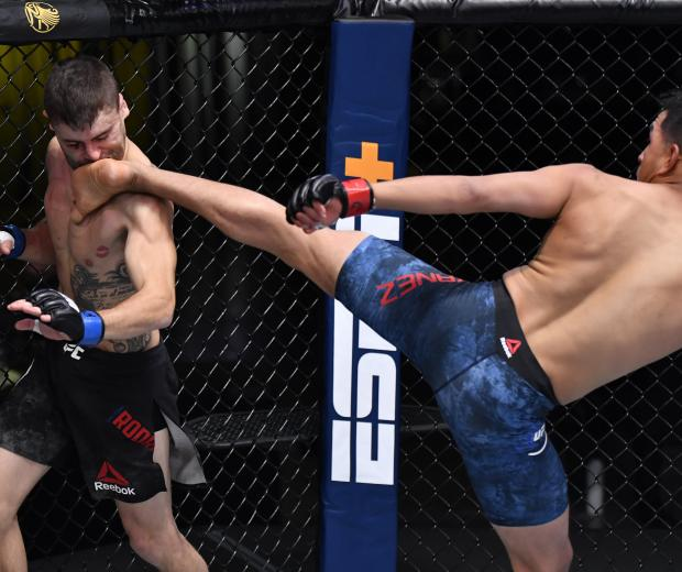 LAS VEGAS, NEVADA - OCTOBER 31: (R-L) Adrian Yanez knocks out Victor Rodriguez with a kick in a bantamweight bout