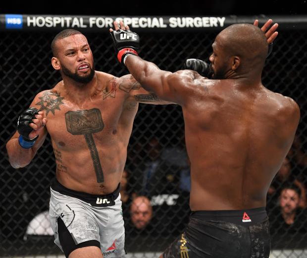 LAS VEGAS, NV - JULY 06: Thiago Silva of Brazil punches Jon Jones in their UFC light heavyweight championship fight during the UFC 239